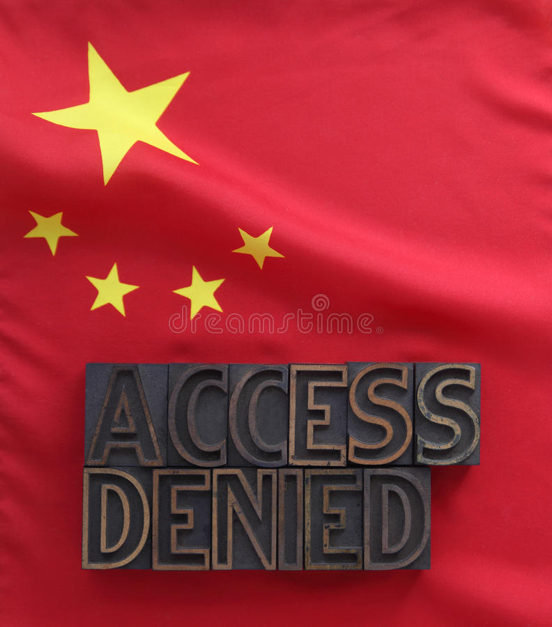 Chinese flag with access denied words. The words access denied in old wood type on a Chinese flag royalty free stock image