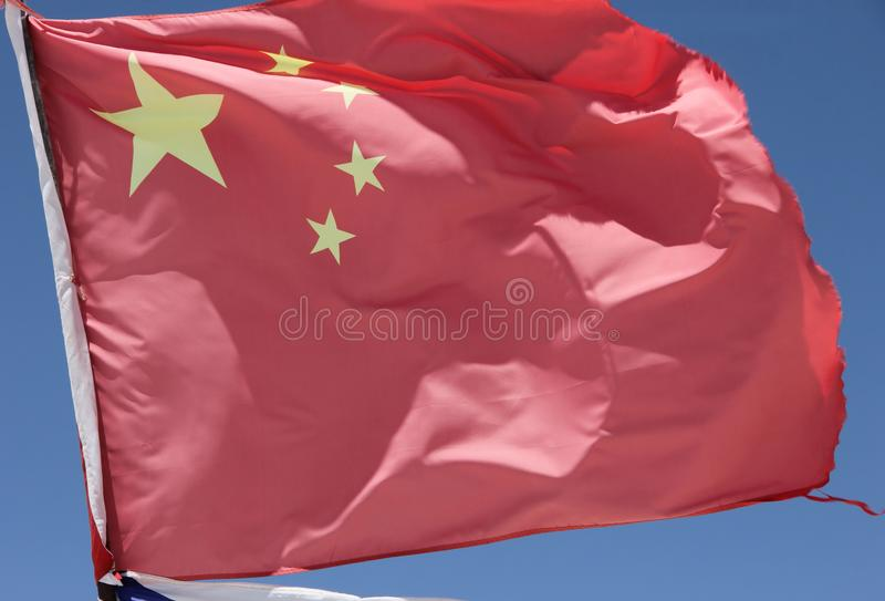 The Chinese Flag flying over the Salt Flats. As part of a monument to the Dakar Races at Salar de Uyuni, Bolivia stock images