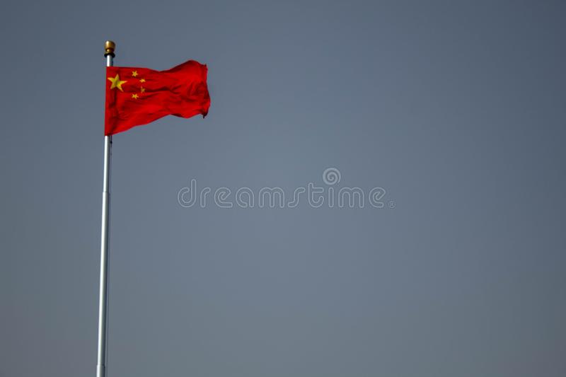 Chinese flag raised high. stock images