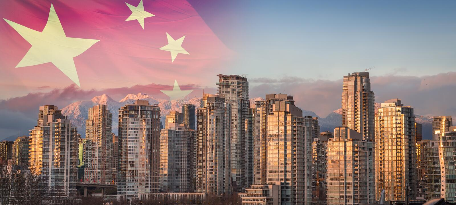 A Chinese flag superimposed over a sunset view of downtown Vancouver, BC, with a view of the snowy mountains in the royalty free stock photo