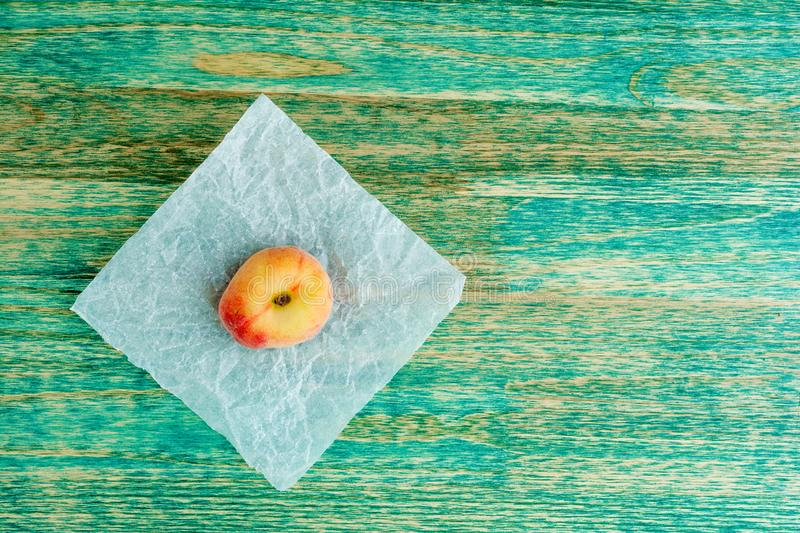 Chinese flat peaches on rustic colorful background with copy space. Flat lay background. royalty free stock photography