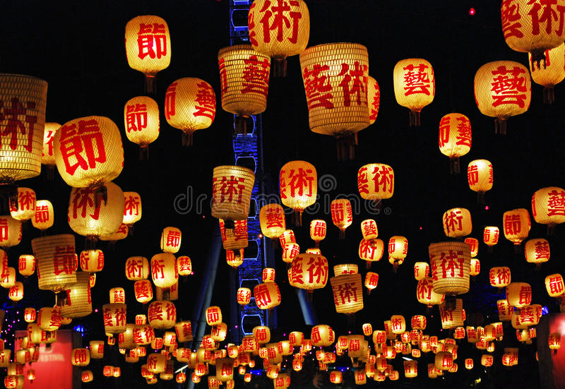 Chinese floating candle lanterns fill sky Brisbane with hope for new year. Lighted Chinese floating candle lanterns fill the sky across the Brisbane River at royalty free stock photo