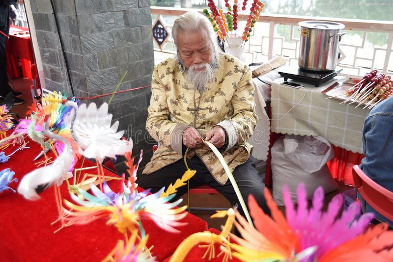 A Chinese folk artist is making dolls with rattan. This traditional handicraft has a history of thousands of years, ancient production methods, and profound stock image