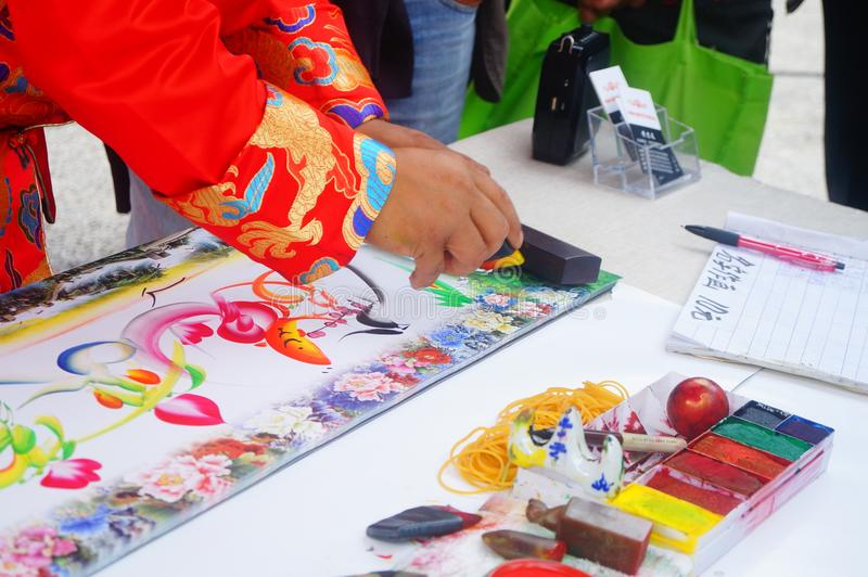 Chinese folk artists paint in their names. In shenzhen, china royalty free stock image