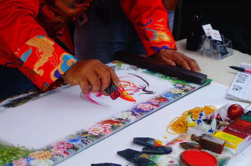 Chinese folk artists paint in their names. In shenzhen, china stock photos
