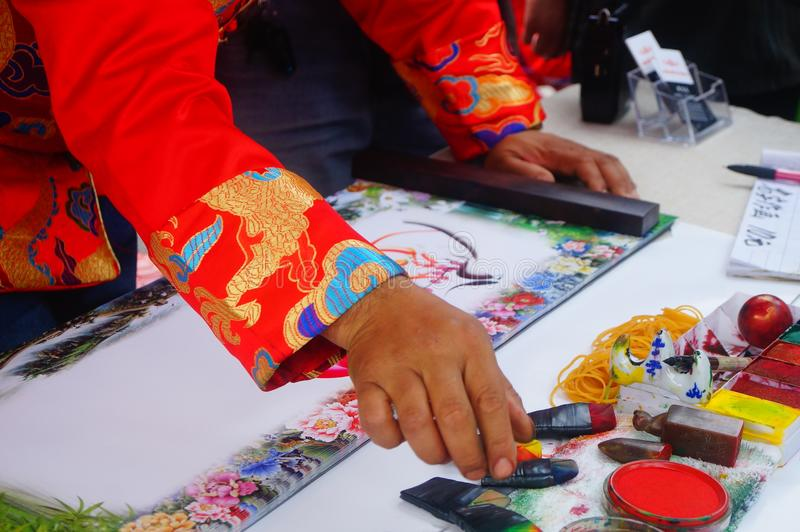 Chinese folk artists paint in their names. In shenzhen, china royalty free stock images