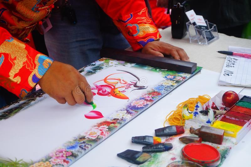 Chinese folk artists paint in their names. In shenzhen, china stock image