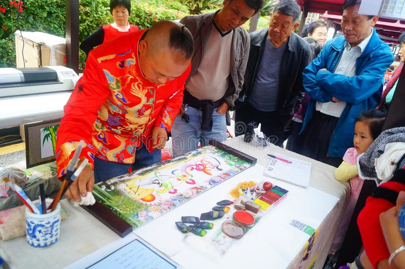 Chinese folk artists paint in their names. In shenzhen, china stock photo