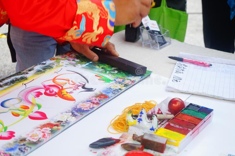 Chinese folk artists paint in their names. In shenzhen, china royalty free stock photos