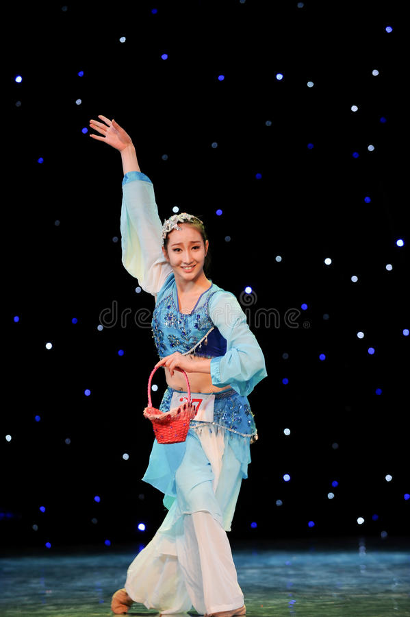 Chinese folk dance-Basket. This is a chinese folk dance which will be performed during harvest season。The Chinese people have many kinds of folk dances royalty free stock photos