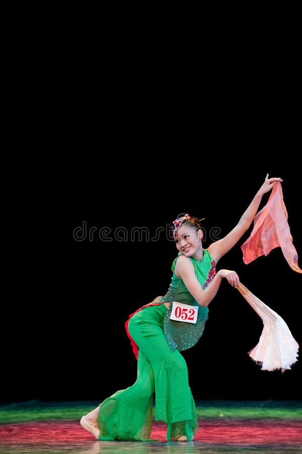 Chinese folk dance-fan dance. This is a chinese folk dance which will be performed during harvest season。The Chinese people have many kinds of folk dances stock photos