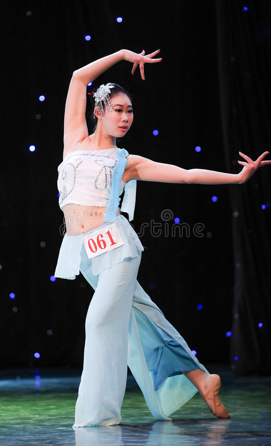 Chinese folk dance-han dance. This is a chinese folk dance which will be performed during harvest season。The Chinese people have many kinds of folk dances stock photography