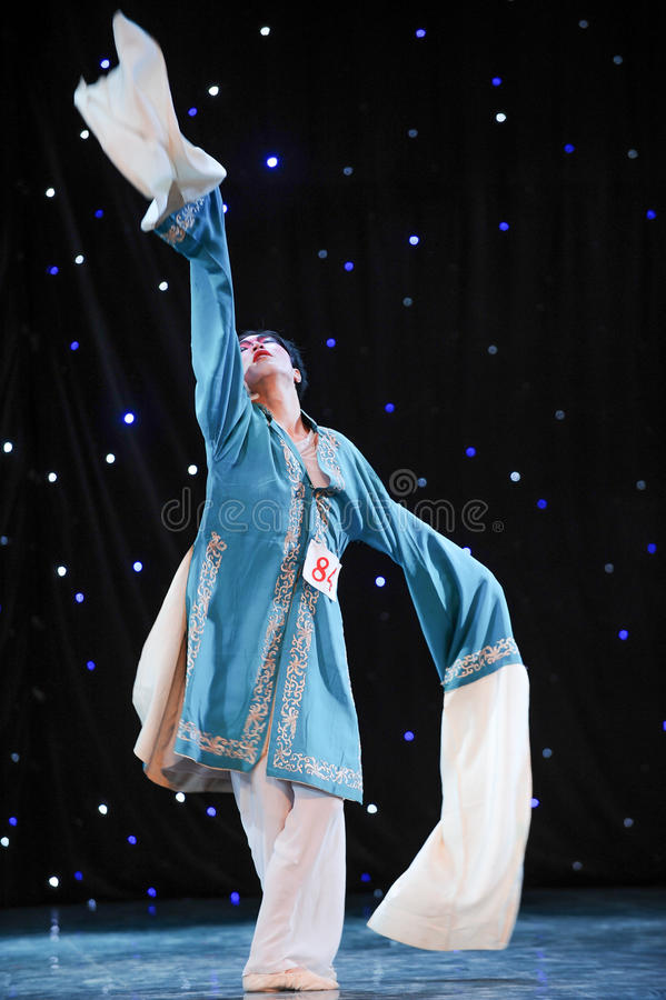 Chinese folk dance-Long sleeves. This is a chinese folk dance which will be performed during harvest season。The Chinese people have many kinds of folk royalty free stock photos