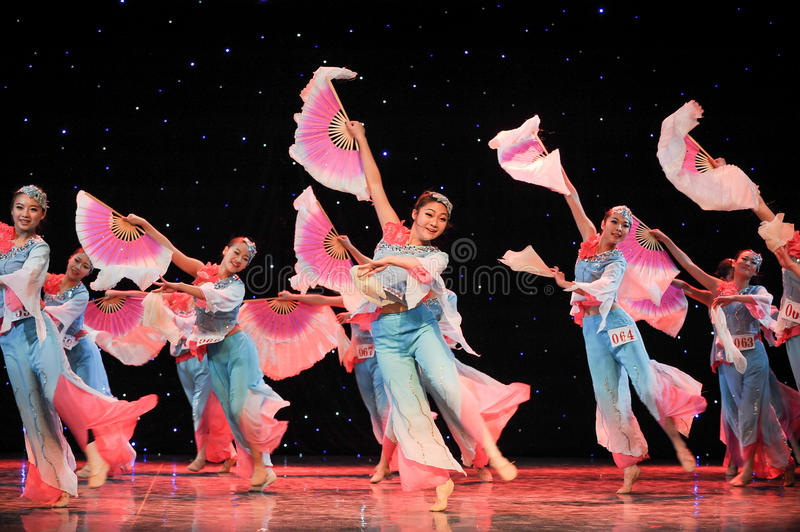 Chinese folk dance- Many people fan dance. This is a chinese folk dance which will be performed during harvest season。The Chinese people have many kinds royalty free stock photo