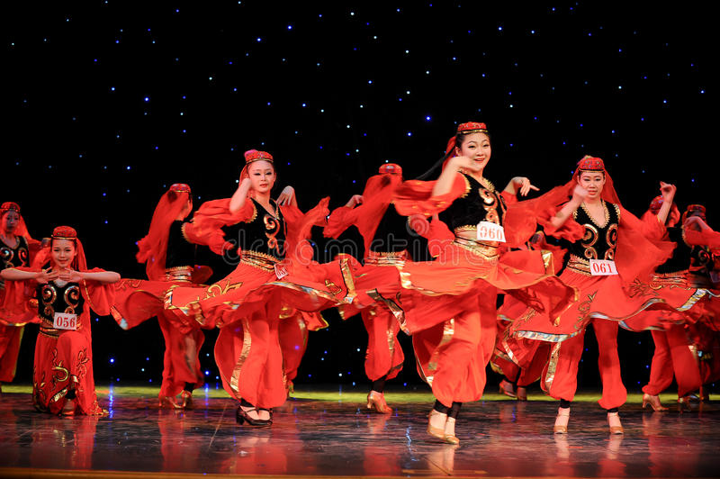 Chinese folk dance-Uighur dance. This is a chinese folk dance which will be performed during harvest season。The Chinese people have many kinds of folk stock photography