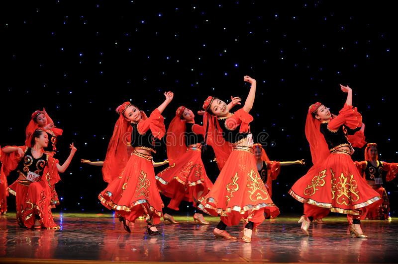 Chinese folk dance-Uighur dance. This is a chinese folk dance which will be performed during harvest season。The Chinese people have many kinds of folk stock images