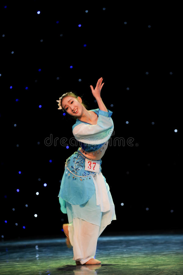 Chinese folk dance. This is a chinese folk dance which will be performed during harvest season。The Chinese people have many kinds of folk dances which can royalty free stock photography