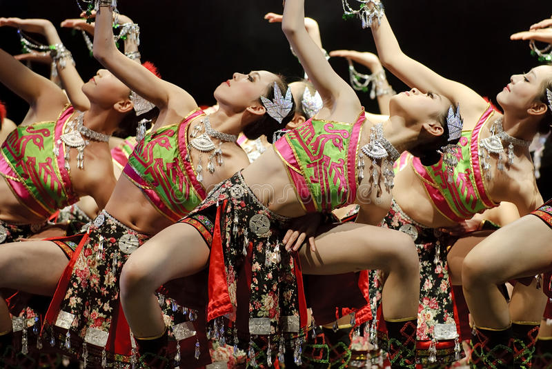 Chinese folk dancers. CHENGDU - DEC 12: chinese dancers perform modern group dance on stage at JINCHENG theater in the 7th national dance competition of china on stock photos
