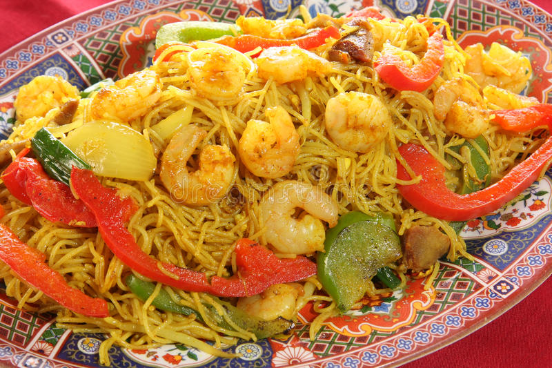 Chinese food. Of curry prawns, vegetables and noodles stock photography