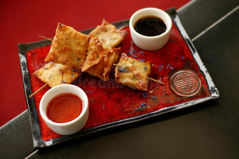 Chinese food. On red plate stock photography