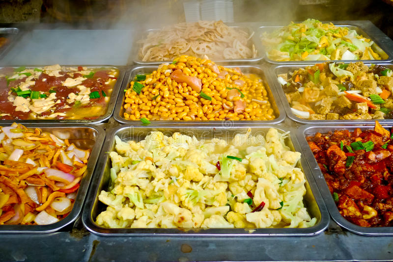 Chinese food buffet. Buffet trays of chinese food in Shanghai, China royalty free stock photography