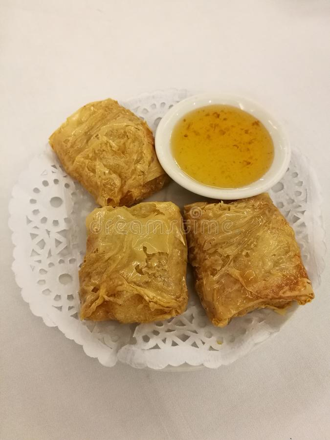 Chinese food in China town, Crispy deep fried tofu skin stuff with shrimp and pork serve with sweet plum sauce in the local tradi royalty free stock images