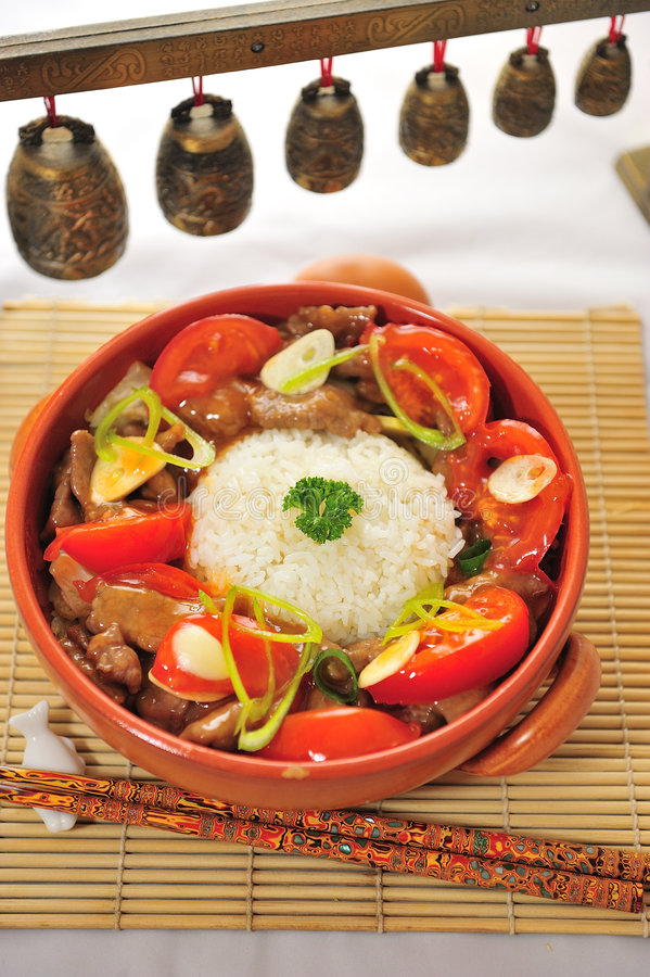Free Chinese Food Cup Of Rice With Pork Tomato Stock Photography - 7834512