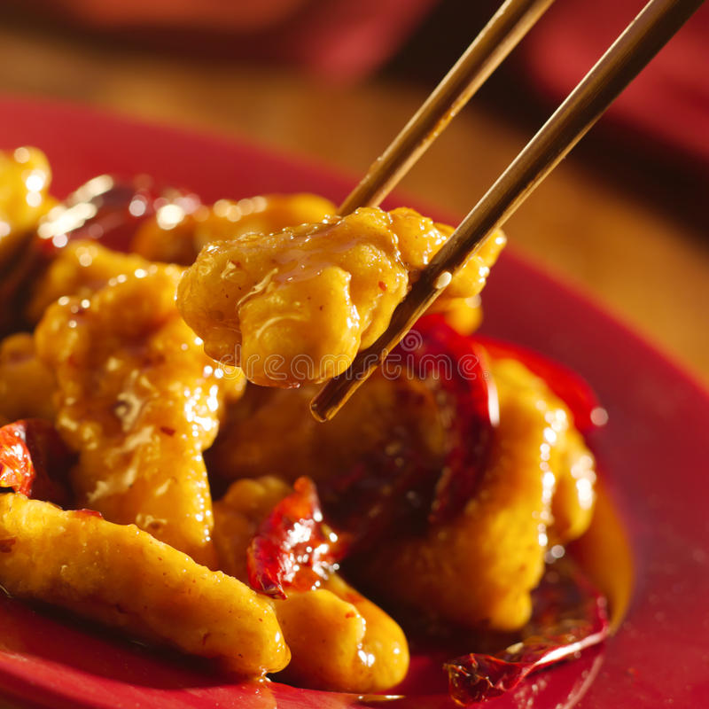 Chinese food - Eating general tso's chicken with c stock image