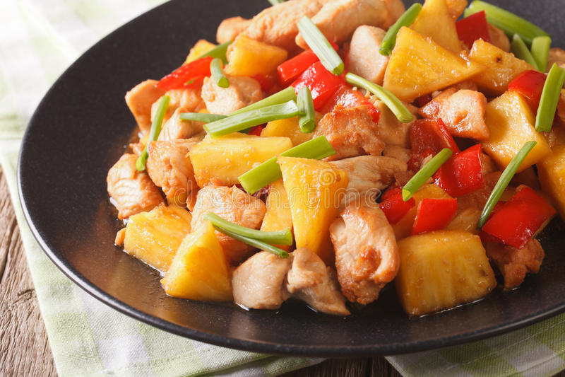 Chinese food: fried chicken with pineapple in sweet and sour sauce close-up. horizontal royalty free stock photos