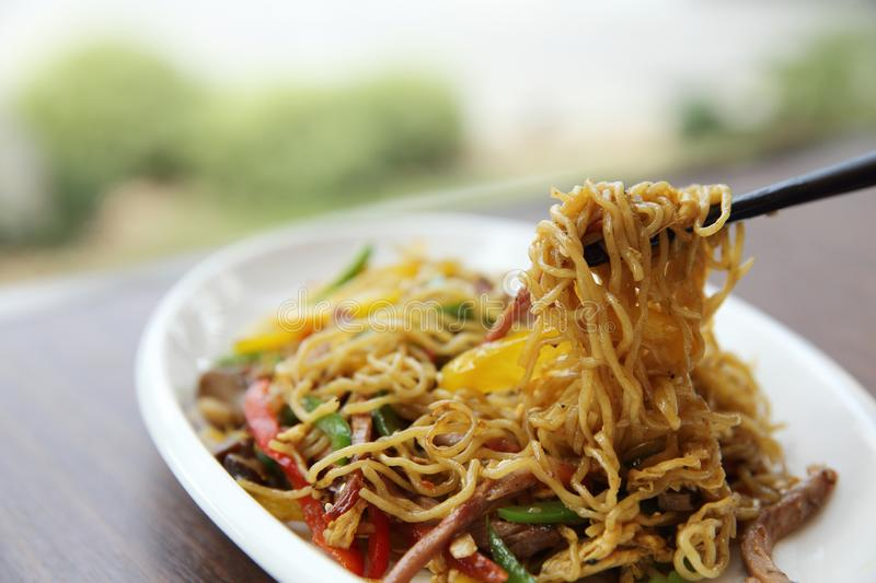 Chinese food fried noodle with ham royalty free stock photography