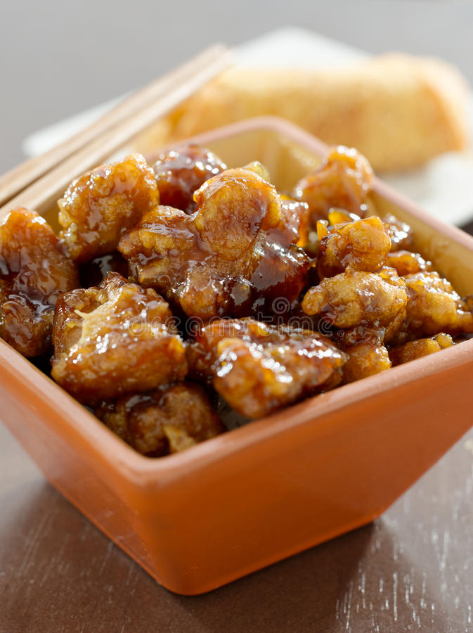 Chinese food - general tso's chicken. Closeup photo of general tso's chicken in a bowl stock photos