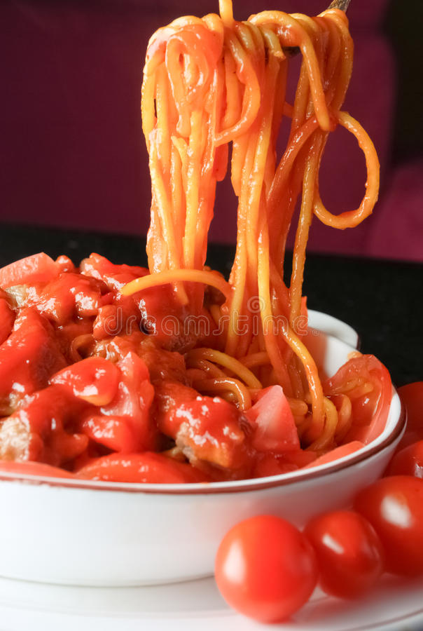 Chinese food- noodles with tomato and egg sauce royalty free stock image
