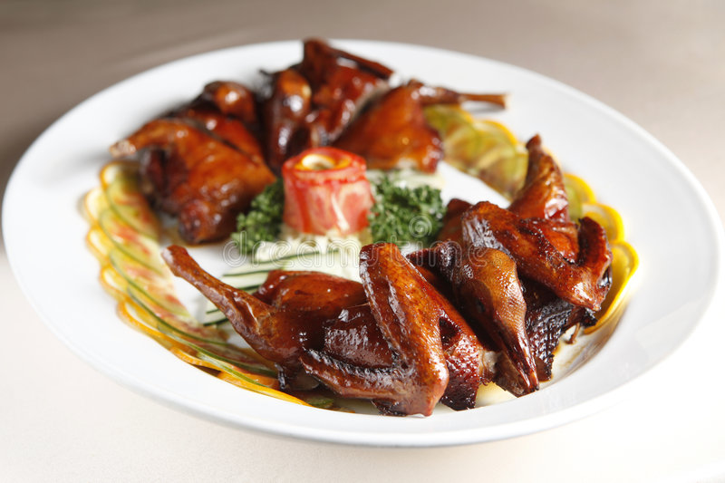 Chinese food, pigeon. On the dish royalty free stock photography