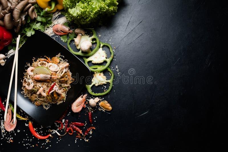 Chinese food preparing craft noodle seafood prawn royalty free stock images