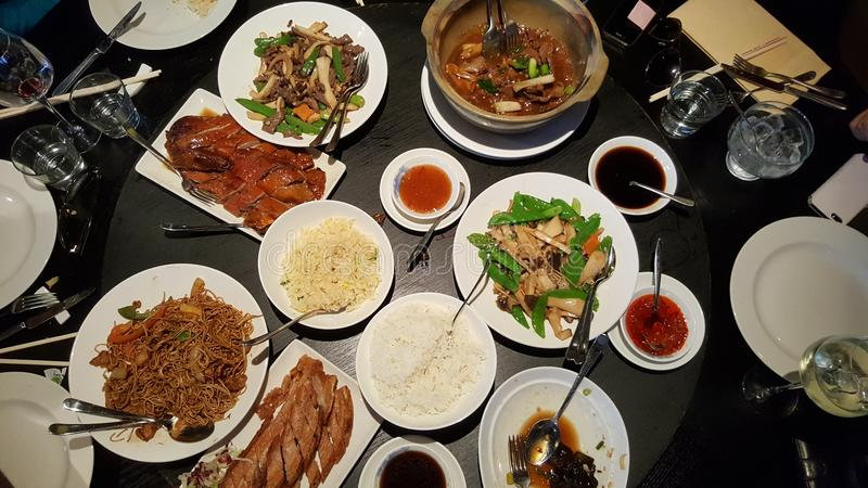 Chinese food in a restaurant. Overhead view of plates of Chinese food in a restaurant stock photos