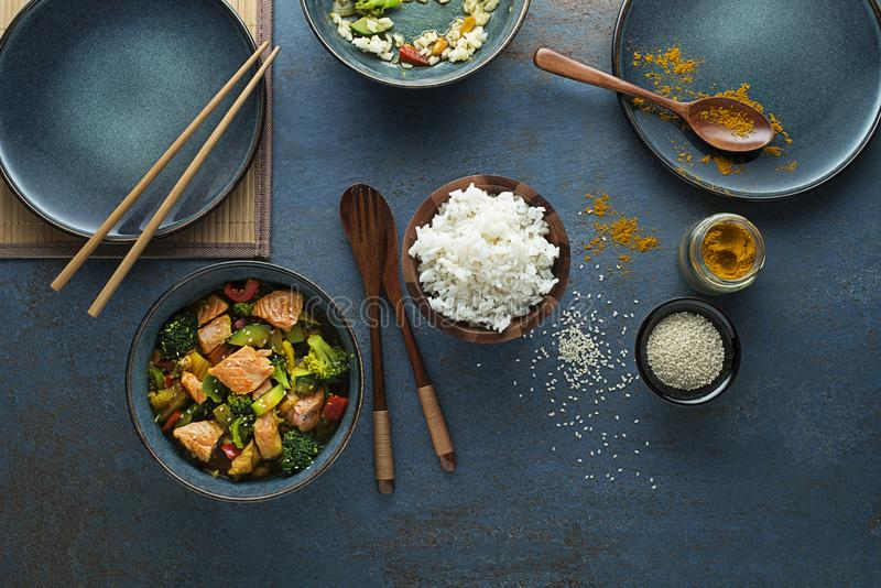 Chinese food with salmon fish and vegetable stock image