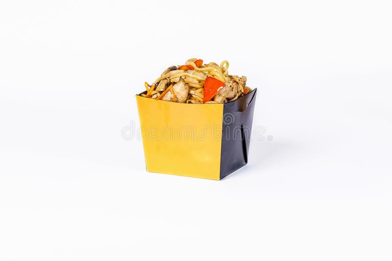 Chinese food. Stir fry noodles with chicken and vegetables on white background. In take away wok noodles box.  stock images