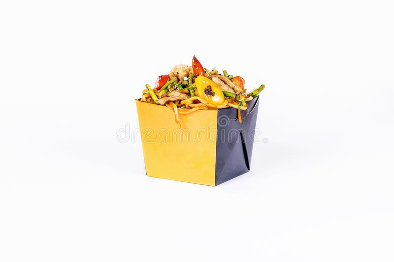 Chinese food. Stir fry noodles with chicken on white background. In take away wok noodles box stock photography