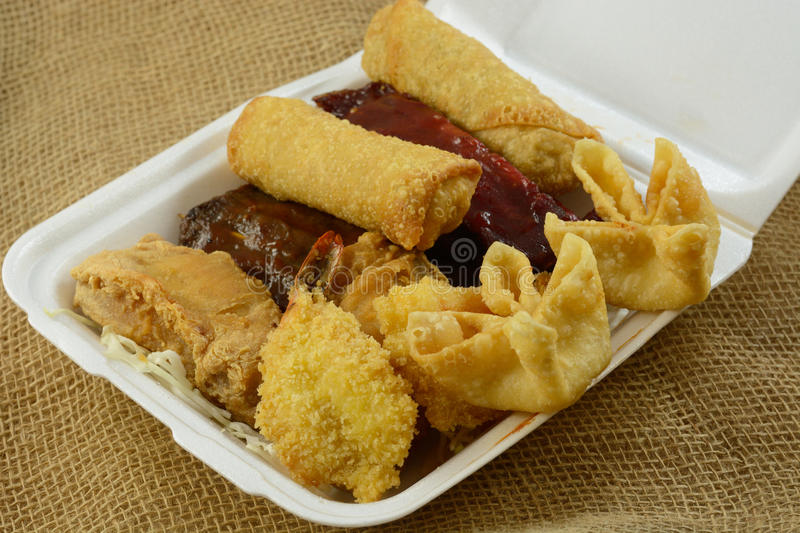 Chinese food take out Pu Pu platter. For two with cheese wontons, fantail shrimp, egg rolls, chicken wings, beef skewers, BBQ spare ribs stock image