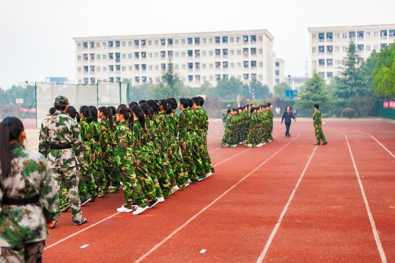 Chinese freshmen college students during military training. Chinese freshmen college students are standing stand still during military training at school. view royalty free stock image