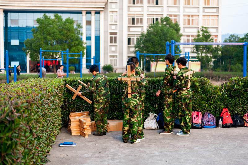 Chinese freshmen college students at military training. Chinese freshmen college students are getting ready for military training at school stock image