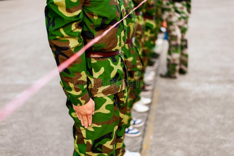 Chinese freshmen college students at military training. Chinese freshmen college students are lining up while standing still during military training at school stock images