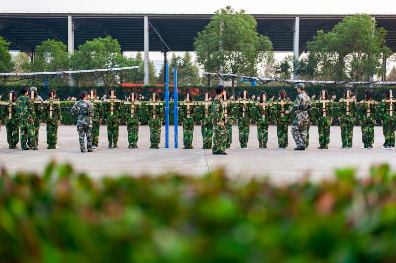 Chinese freshmen college students at military training. Chinese freshmen college students are standing stand still during military training at school. view from royalty free stock photo