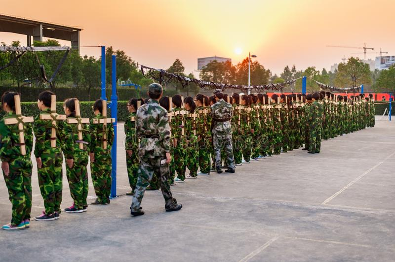 Chinese freshmen college students at military training. Chinese freshmen college students are standing stand still during military training at school.view from royalty free stock photos