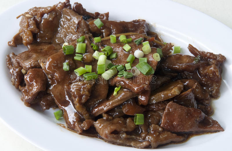 Chinese Fried Beef. Chinese style stir fried beef slices with spring onion stock photos