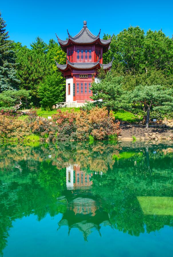 Pagoda and pond at Chinese garden royalty free stock photos