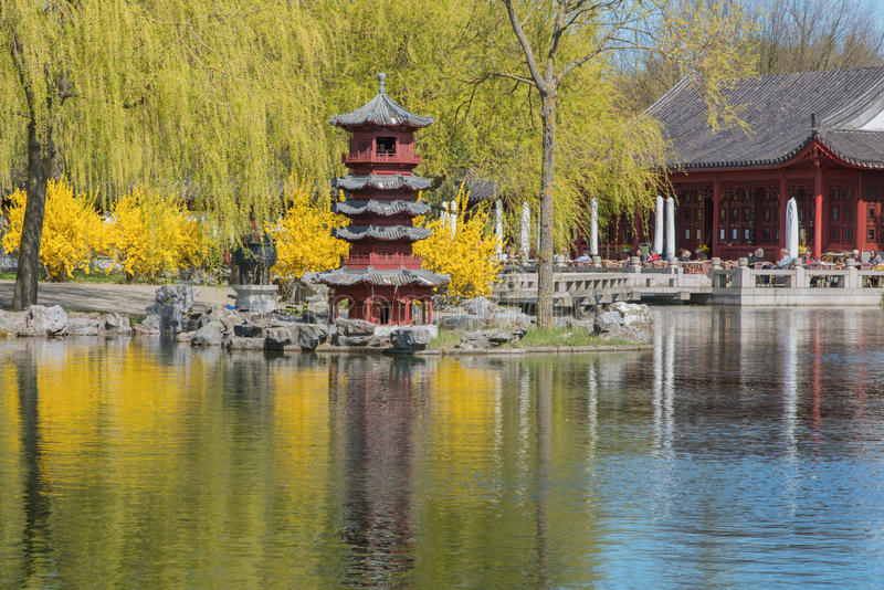 Chinese Garden of the Reclaimed Moon. Lake with pagoda and tea house stock images