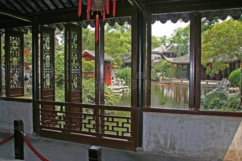Chinese garden seen from the inside of a pavilion, Suzhou, China royalty free stock images