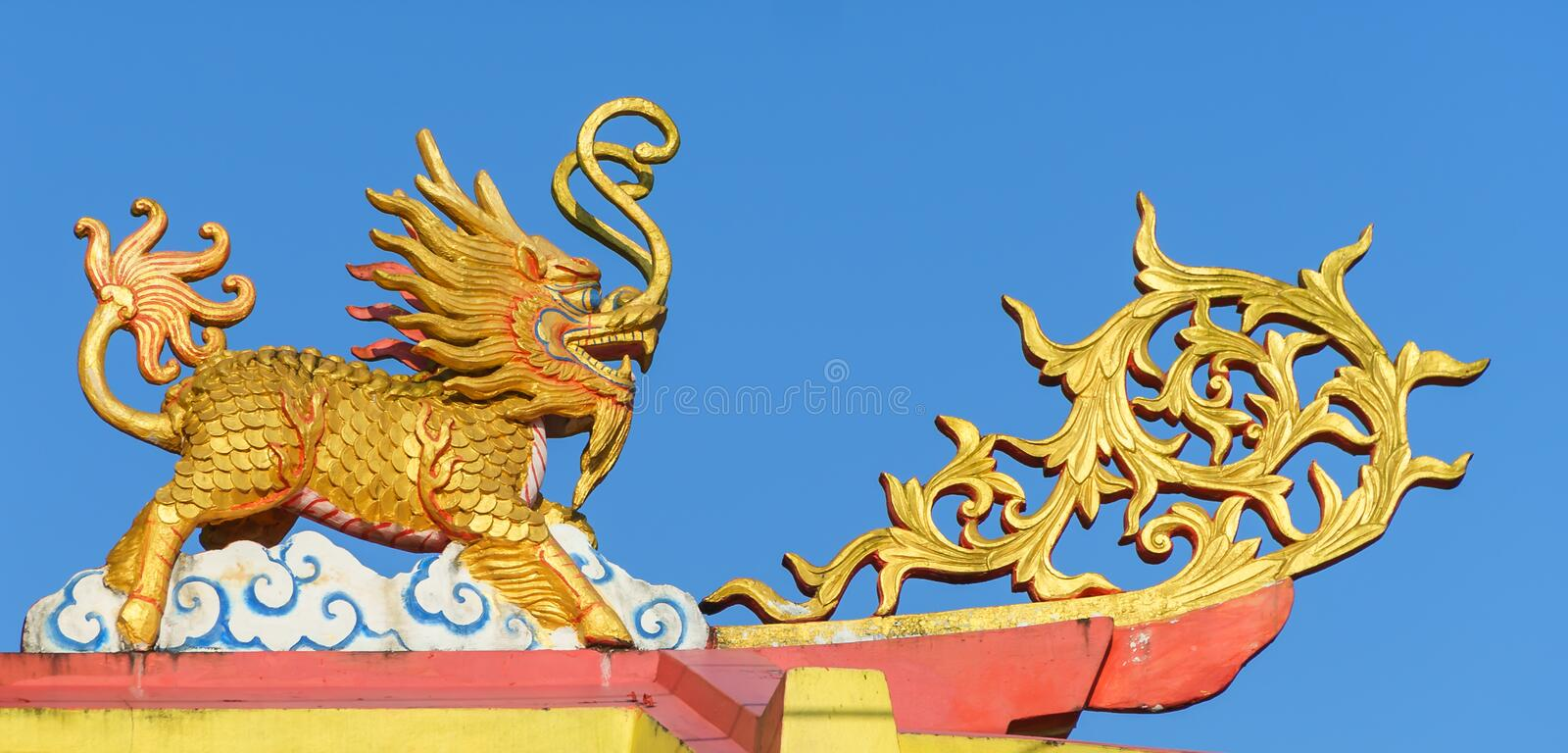 Chinese Ghilen on the shrine roof. stock images