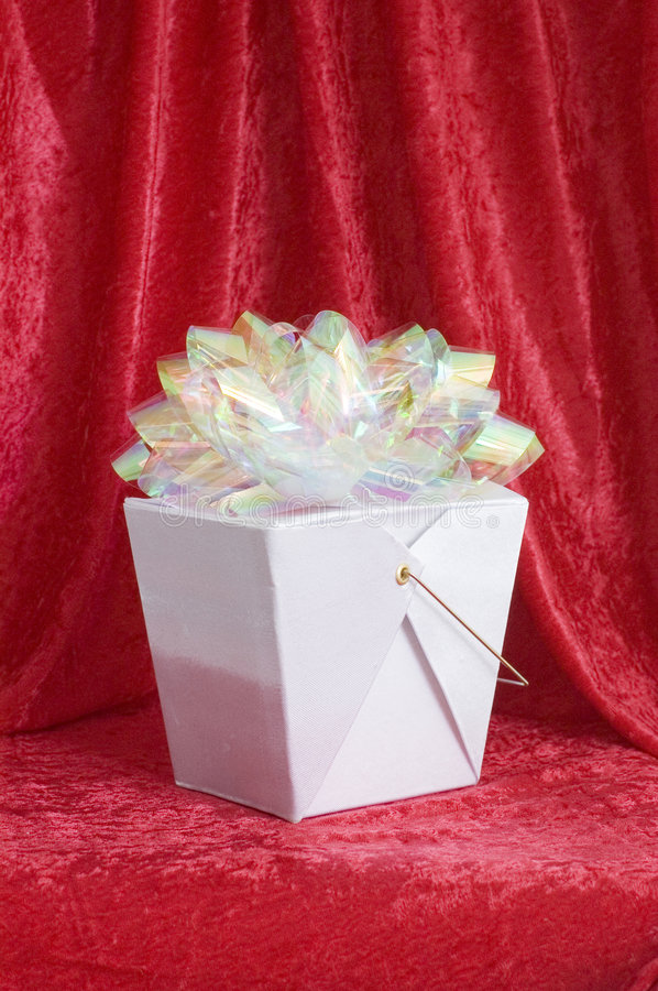 Chinese gift box with bow. Iridescent bow on a Chinese gift box stock photo